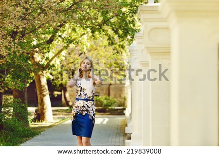 fashion young model walking  in park - stock photo