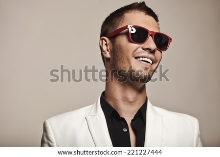 Fashion young with fashionable sunglasses on gray background