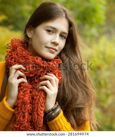 Fashion young woman walking in autumn park - stock photo