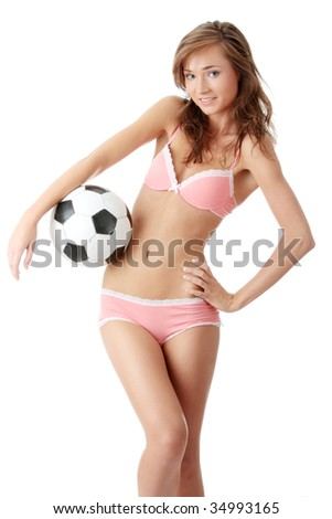 Fashion young woman with a football ball isolated over a white background