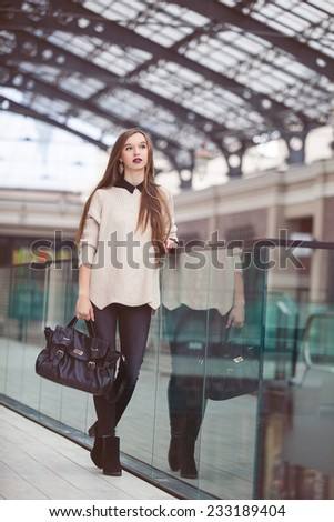 Fashion Young Woman with a leather bag. Fashion photo
