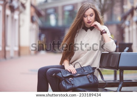 Fashion Young Woman with a leather bag. Fashion photo - stock photo