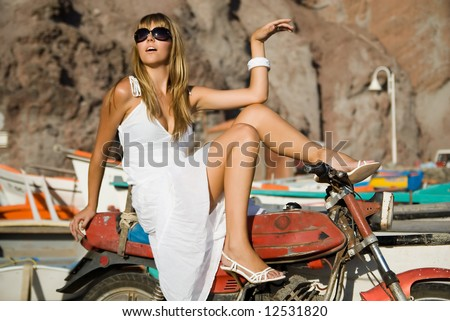 Fashion young woman with a motorcycle - stock photo
