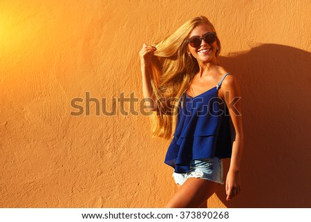 Fashion young woman with long legs in summer clothes - stock photo