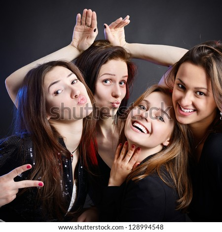 fashionable attractive happy party teen girls have fun, over black background