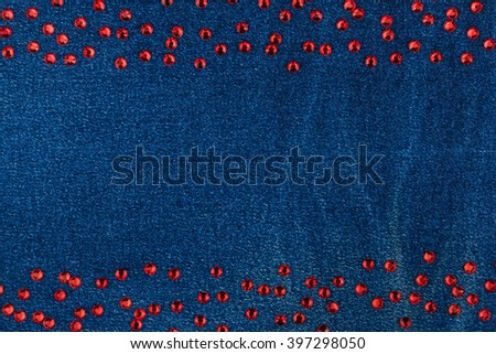 Fashionable background, denim  and red  rhinestones, with space for your text - stock photo