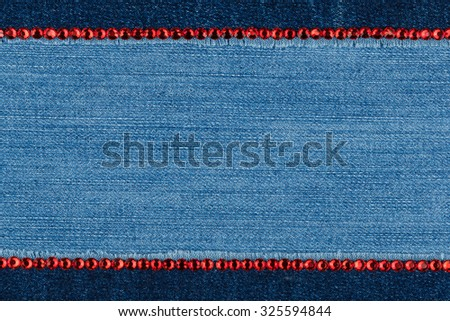 Fashionable background,  jeans and red  rhinestones, with space for your text