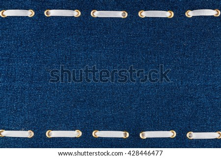 Fashionable background white satin ribbon inserted in denim, with space for your creativity
