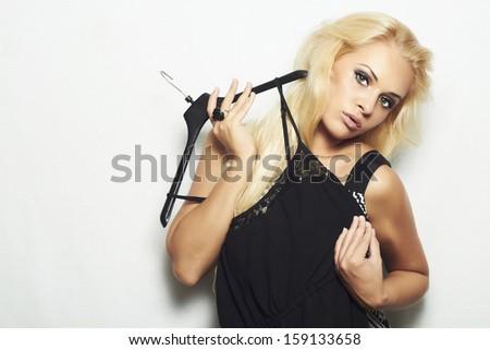 fashionable beautiful blond woman.shopping.Trying black dress - stock photo