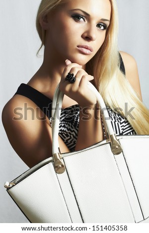 fashionable beautiful blond woman with with handbag. shopping. beauty girl. professional make-up. style. fashion - stock photo