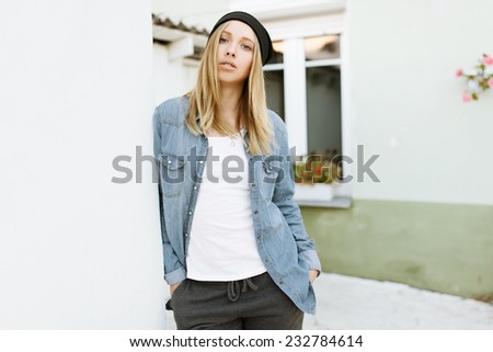 Fashionable beautiful girl standing in pose - stock photo
