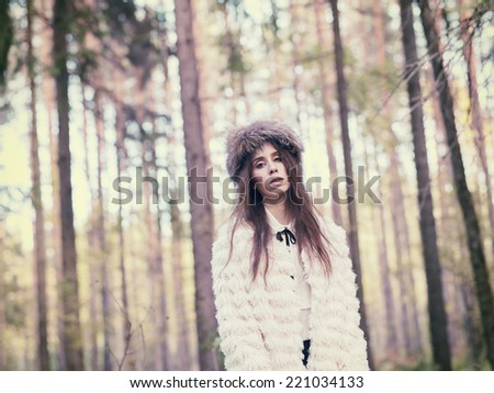 Fashionable beautiful woman in the forest - warm tinted image