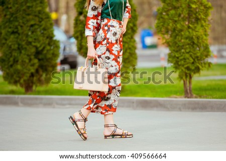 Fashionable beautiful woman with handbag on the city streets. - stock photo