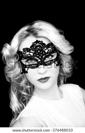 Fashionable beautiful young  blonde woman in mask