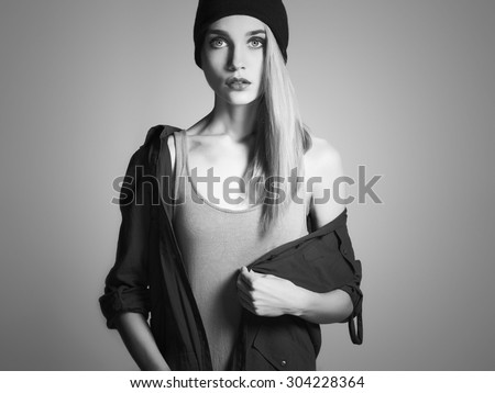 fashionable beautiful young woman in hat. beauty blond girl in cap. casual wear.autumn fashion collection