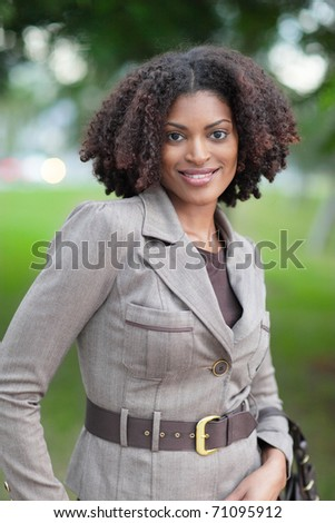 Fashionable black woman smiling - stock photo