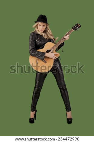 Fashionable blond woman rocker over a green background