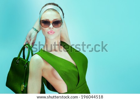 Fashionable blonde beautiful woman posing in dress . Summer photo. - stock photo