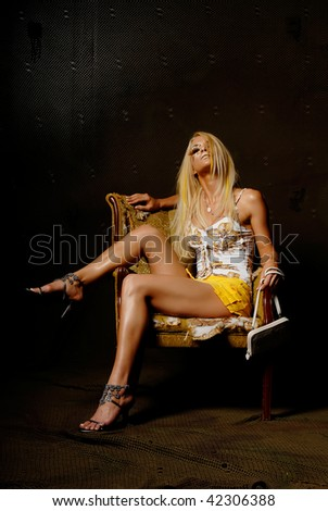 Fashionable blonde woman in mini skirt