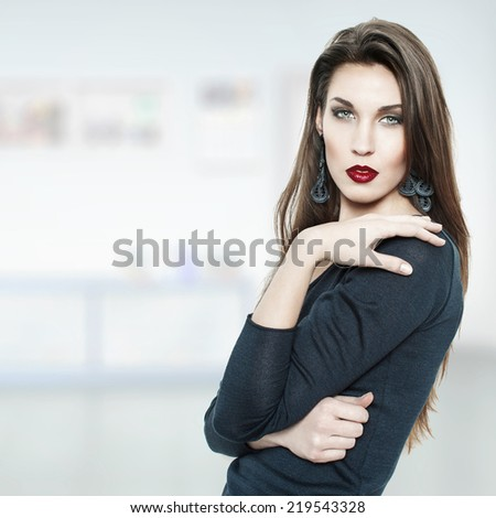 Fashionable brunette woman at home, indoor portrait - stock photo