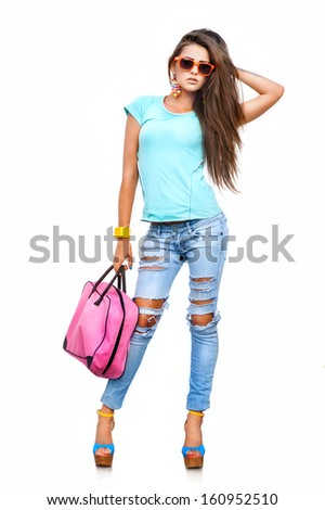 Fashionable charming young woman in stylish jeans and sunglasses posing against white background - stock photo