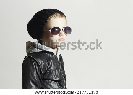Fashionable child boy in sunglasses. Child in Black cap. Winter style.Little boy.Kids fashion