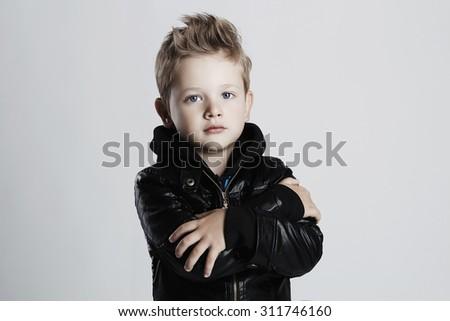 Fashionable child in leather coat.stylish little boy. Autumn fashion.funny 6 years old kid - stock photo