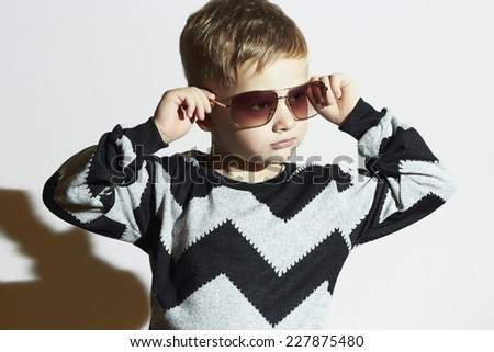 Fashionable child in sunglasses and sweater.Little boy.Kids fashion - stock photo