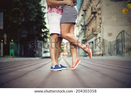 Fashionable cool couple, legs, lifestyle - stock photo