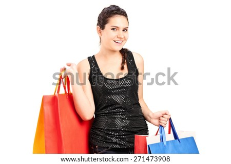 Fashionable female holding bunch of shopping bags isolated on white background - stock photo