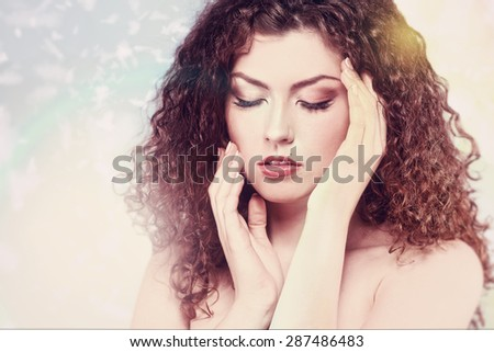 Fashionable female portrait over abstract backgrounds. Vogue style brunette girl.