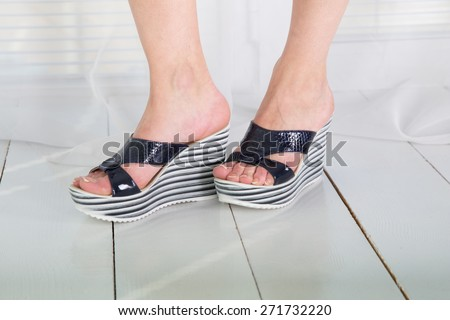 Fashionable footwear on female feet - stock photo