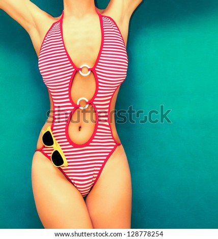 fashionable girl in a swimsuit on the water - stock photo