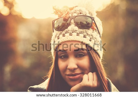 Fashionable girl outdoors. - stock photo