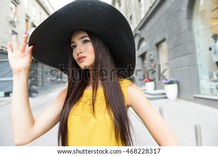 Fashionable girl relaxing in town