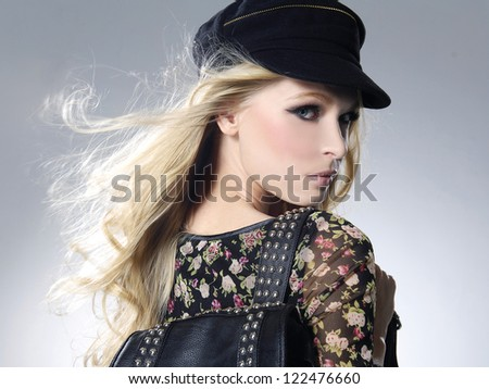 fashionable girl with hat with bag posing in the studio