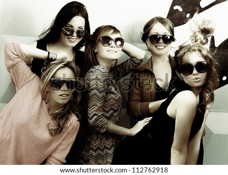 fashionable girls in sunglasses - stock photo