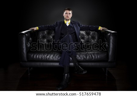 Fashionable groom or businessman wearing a blue formal wedding suit with yellow shirt and tie. Trendy modern fashion in classic style.  Business suit fashion.