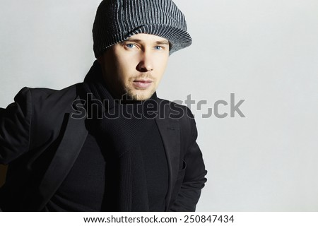 Fashionable Handsome Man in Black scarf.Stylish Boy in hat.Young man.spring casual fashion - stock photo