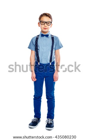 Fashionable handsome serious small boy in glasses. Full - length. Isolated on a white background. - stock photo