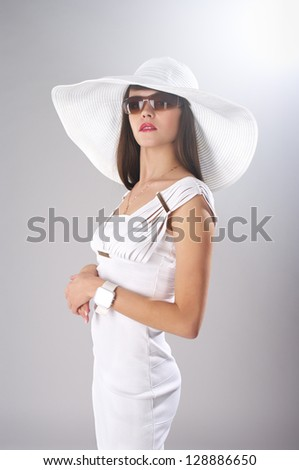 Fashionable lady in elegant white clothes - stock photo