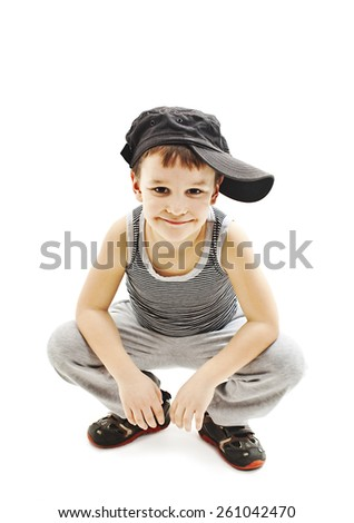 Fashionable little boy.Hip-Hop Style. fashion children.handsome blond kid. Pose Boy in Tracker Hat. Young Rapper. Funny Child in Cap. 5 years old  - stock photo