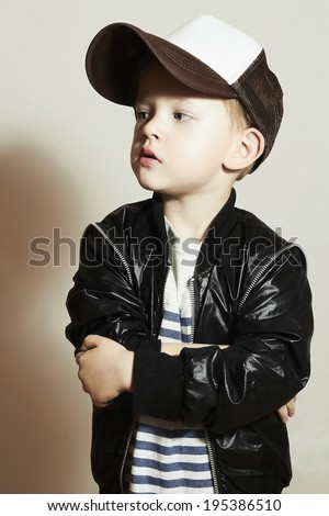 Fashionable little boy.Hip-Hop Style. fashion children.handsome blond kid with big blue eyes.Pose Boy in Tracker Hat. Young Rapper. Funny Child in Cap. 4 years old - stock photo