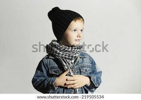 fashionable little boy in scarf and jeans.winter style.fashion kids.funny child - stock photo