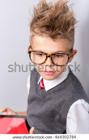 Fashionable Little Boy In Sunglasses And Funny Hairstyle Using Tablet With Empty Screen Stylish Kid