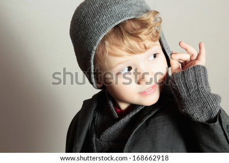 Fashionable Little Boy.Stylish Handsome Kid. Fashion Children. in suit, sweater and cap. Winter Style - stock photo