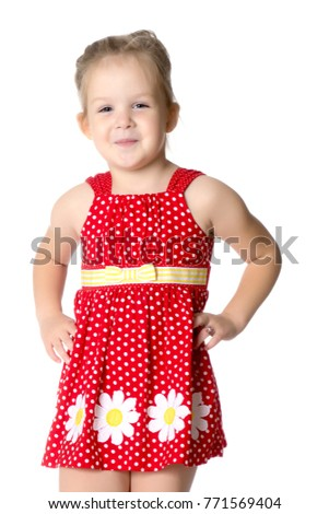 Fashionable little girl in a dress. Beauty and style in children's clothes. Isolated over white background