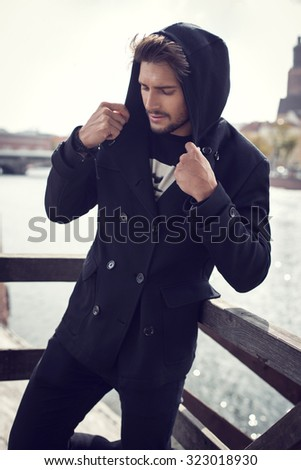 Fashionable man in coat - stock photo