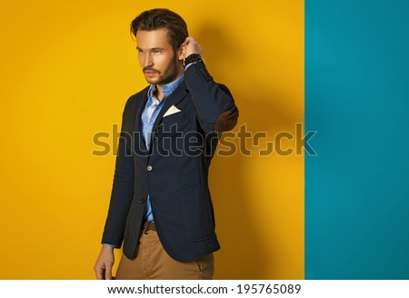 Fashionable man wearing jacket and posing