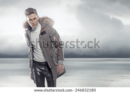 Fashionable man wearing winter jacket - stock photo